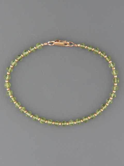 Peridot Bracelet - 4mm faceted roundels with Gold beads - P902